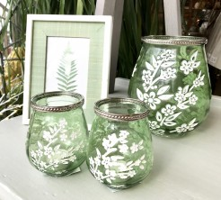 Green Hurricane with White Blossom Decoration