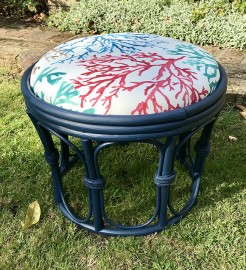 Vintage upcycled rattan stool with coral fabric